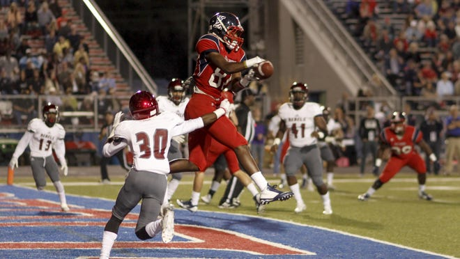 Rebel's wide receiver Johnny Johnson (81) receives a catch in the end zone for a touchdown.