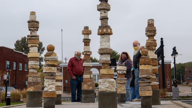 "Towers of ceramic pieces make up the new permanent sculpture titled ""The Travelers"" in NOTO's Redbud Park. The artists who created the pieces gathered Wednesday afternoon to meet via Zoom with Phoenix-based sculptor Patricia Sannit, who helped get the sculpture idea going two years ago while she was visiting for a workshop."