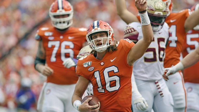 FILE - In this Oct. 12, 2019, filer photo, Clemson quarterback Trevor Lawrence (16) reacts after scoring a touchdown during the first half of an NCAA college football game against Florida State, in Clemson, S.C. Clemson is preseason No. 1 in The Associated Press Top 25, Monday, Aug. 24, 2020.