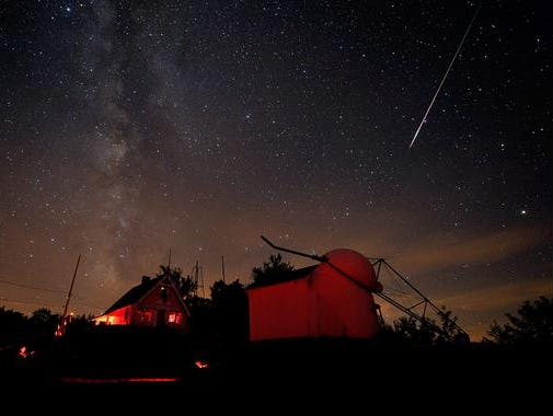 A bright Perseid meteor streaked down Saturday night (Aug. 7, 2010) over buildings at the Stellafane amateur astronomy convention in Springfield, Vermont.(Photo: Dennis di Cicco Sky & Telescope)