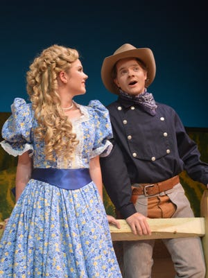 "Hannah Sharpe as Laurey and Andy Terwilliger as Curly in the University of West Florida's production of ""Oklahoma!"""