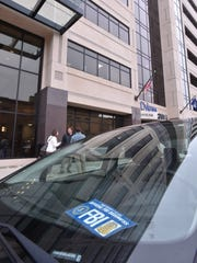 Vehicles with FBI cards parked outside Senate office building where Detroit Senator Bert Johnson's office is located