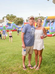 United Against Poverty Founders Austin and Ginnie Hunt at the Burgers & Brews Festival - An American Heritage Celebration to benefit United Against Poverty of Indian River County.