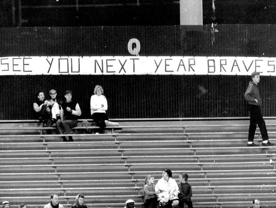 Fans in the bleachers at County Stadium let the Braves