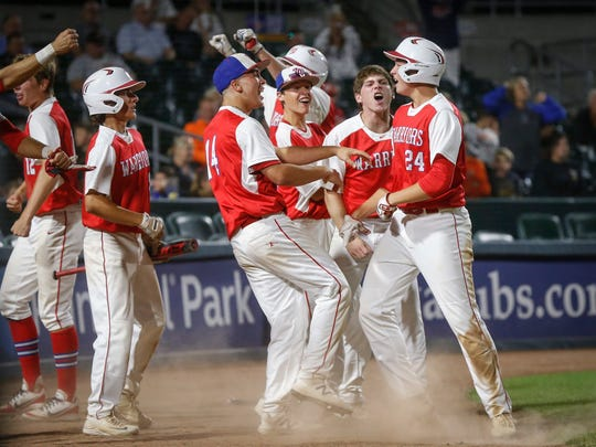 Members of the Cedar Rapids Washington baseball team celebrate a 5-4 win over West Des Moines Valley in Class 4A on Friday, July 27, 2018, at Principal Park in Des Moines.