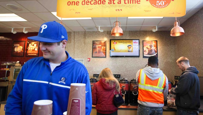 In 2014, Josh Gregor, of Wilmington, gets some hazelnut creamer as he enjoys a cup of free coffee.   Josh Gregor of Wilmington gets some hazel nut creamer as he enjoys a cup of free coffee.  Wawa celebrates it's 50th anniversary by giving out free coffee to customers Wednesday April 16, 2014.