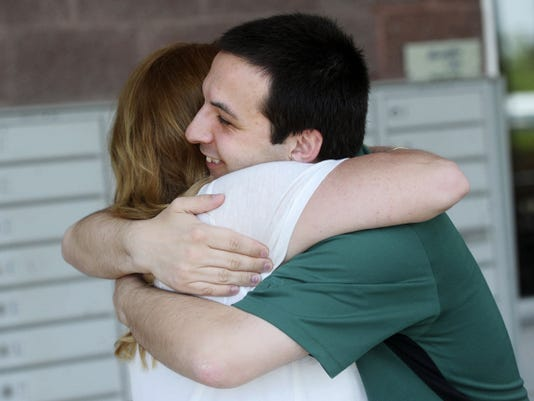 A friend of Chris Boyer's, Michelle Miller, congratulates him one day after he was acquitted of sexually assaulting a student. The former math teacher said he received a lot of support from friends and family after he was charged.