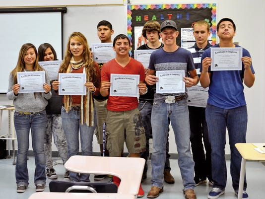 """Elena Ruiz - Headlight Photo   Deming High students completed an eight-week course titled: """"Agents of Change,"""" given by La Pinon Sexual Assault Recovery Services. Sophomores participated in the class to gain better knowledge of how to support - and when necessary - to react to instances of bullying and sexual assault. Only nine of the 12 students are pictured (in no order): Timothy Santana, Jeremiah Talavera, Isabel Barba, Kelcie Burns, Daisy Chavez, Dominique Jacobo, Karina Saldivar, Bryiana Ramirez, Krystal Martinez, Gabrielle Bueno, Destiny Reyes and Erasmo Valenzuela."""