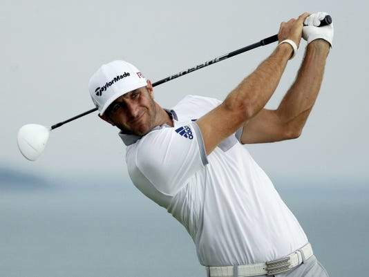 Dustin Johnson hits a drive on the 16th hole during the first round of the PGA Championship on Thursday at Whistling Straits in Haven, Wis.