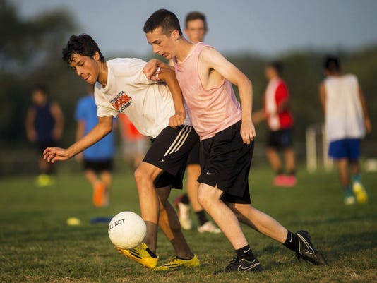 Biglerville's Elijah Garcia, left, and Derek McCleaf compete for the ball during Wednesday's soccer practice at Biglerville High School.