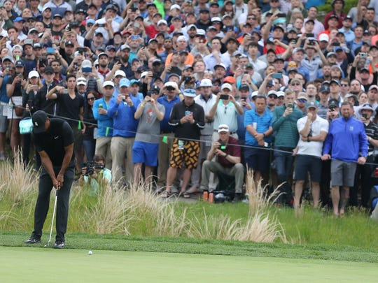 May 17, 2019; Bethpage, NY, USA; Tiger Woods putts on the sixth green during the second round of the PGA Championship golf tournament at Bethpage State Park - Black Course. Mandatory Credit: Brad Penner-USA TODAY Sports
