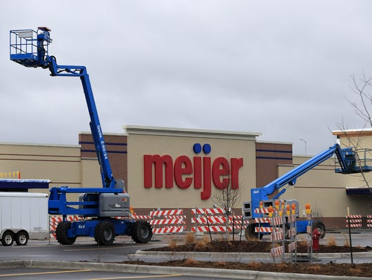 Construction lifts are shown in the parking lot of