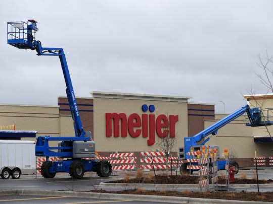 Construction lifts are shown in the parking lot of the Meijer store on Shawano Avenue in Howard.