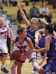 Reno's Mikayla Shults looks to pass the ball with Spanish