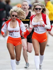 Ashley Long, left, and Sarah Griffin lead runners to