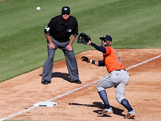 Third baseman Jonathan Villar starts the Astros' triple play in the fifth inning.
