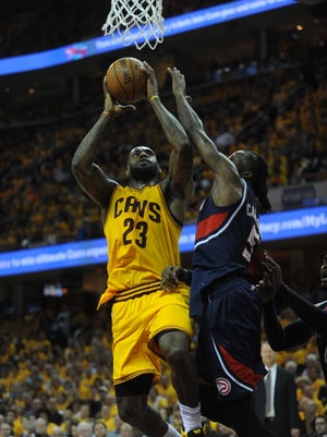 Cleveland Cavaliers forward LeBron James (23) shoots over Atlanta Hawks forward Paul Millsap (4) during the second quarter in game three of the Eastern Conference Finals of the NBA Playoffs at Quicken Loans Arena.