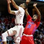 Temple's Jesse Morgan, left, goes up for a basket in front Louisiana Tech's Qiydar Davis, right, during the first half of Temple's 77-59 NIT win Wednesday.