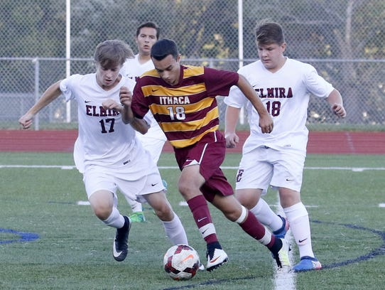 Ithaca's Michael Gualtieri controls the ball in front