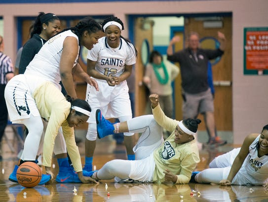 Neumann-Goretti celebrates with Hershey kisses thown