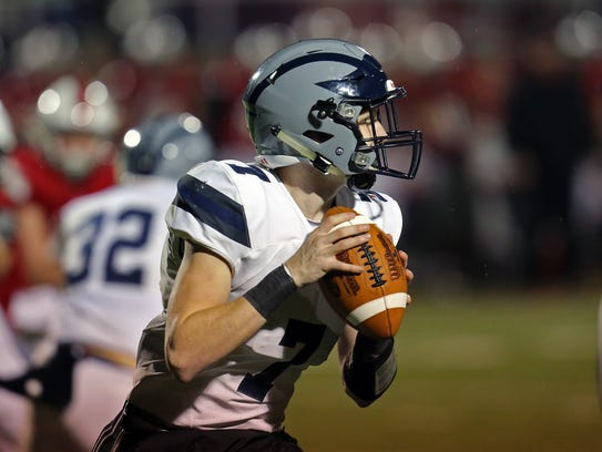 West Clermont quarterback Tyler Steinker rolls out
