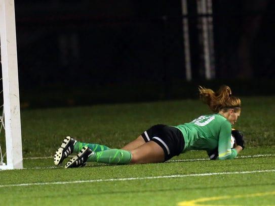 Loveland goalkeep Lauren Parker makes a diving save