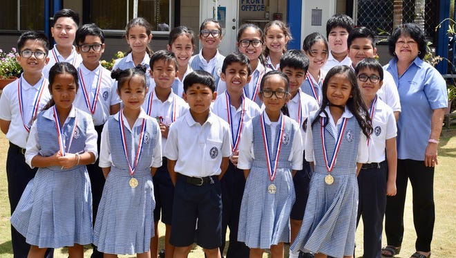 Congratulations to Saint Anthony Catholic School students Class 4B for garnering second place in the UOG Chamoru Language Competition – I Fino' Chamoru: Poksai Mo'na Sahyan I Fino-ta gi i Tano' – Grades 3-5 Children's Choir held at Calvo's Fieldhouse on March 13.  Students were awarded with medals for their winning place. Go Raiders! Pictured front row from left: Rylei-Jo Materne, Jaida Somera, Irish Diaz, Ceanna Termulo, and Taytum Duenas. Second row from left: Dylan Catahay, Gavin Boyd, Riley Cruz, Francisco Taitano, and Ryder Torres. Third row from left: Riley Benavente, Camarin Blancaflor, Taylor Cruz, Abigail Perez, Adam Terbio, and Mrs. Rosa Rodriguez. Fourth row from left: Isaac Baluyut, Celestina Aguon, Joi Perez, Sophia Leon Guerrero, and Leonardo Yoo.