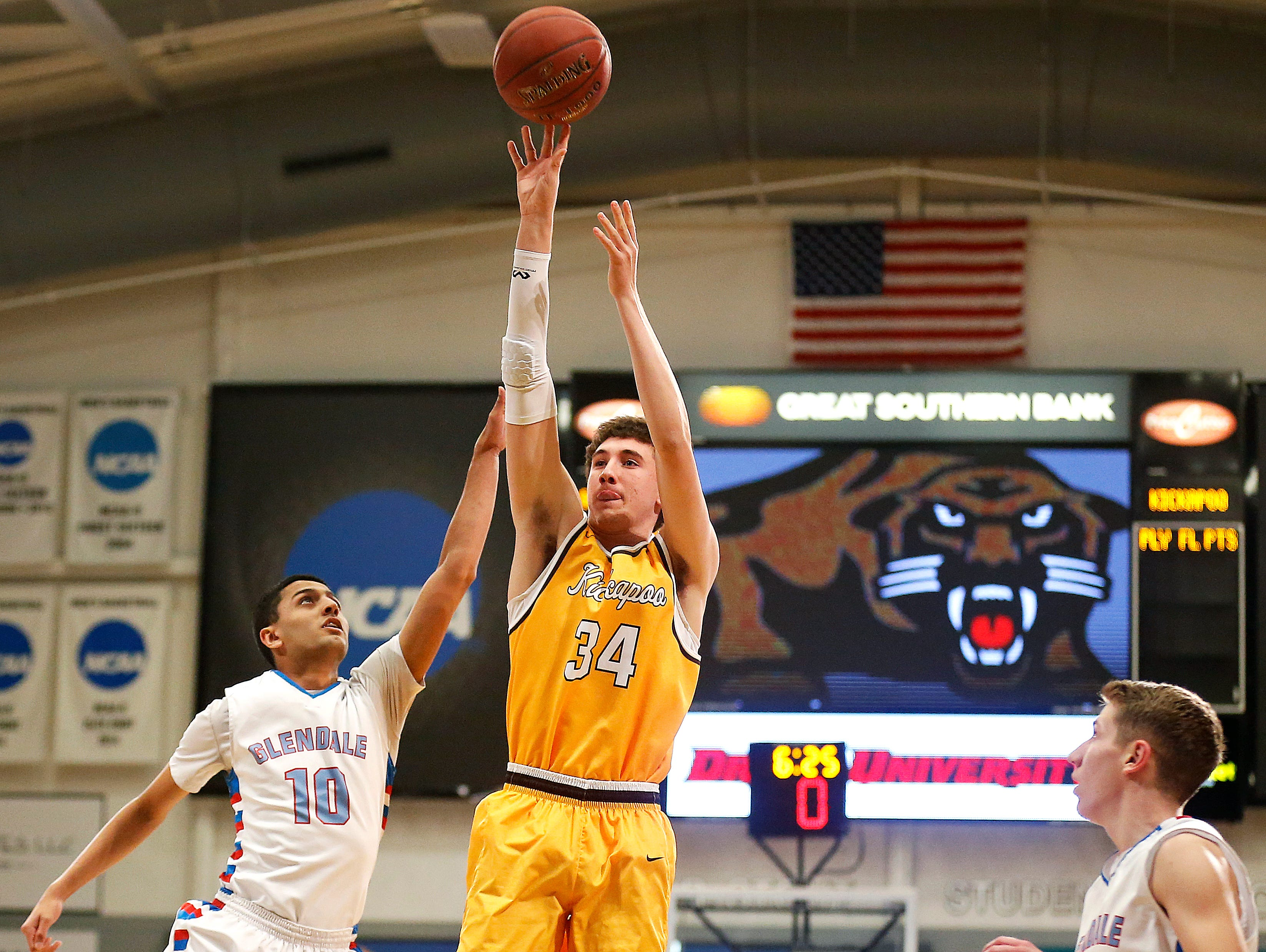 Kickapoo Chiefs senior Jared Ridder (34) shoots the ball from three-point range during first quarter action of the high school basketball game between the Glendale High School Falcons and the Kickapoo High School Chiefs at O'Reilly Family Event Center in Springfield, Mo. on Feb. 7, 2017. The Kickapoo Chiefs won the game 96-77.