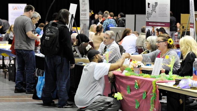 Service providers were available during Project Homeless Connect at the River's Edge Convention Center on Thursday, March 18. The event helps people find a variety of services including job training information, health care, free cellphones and even haircuts.