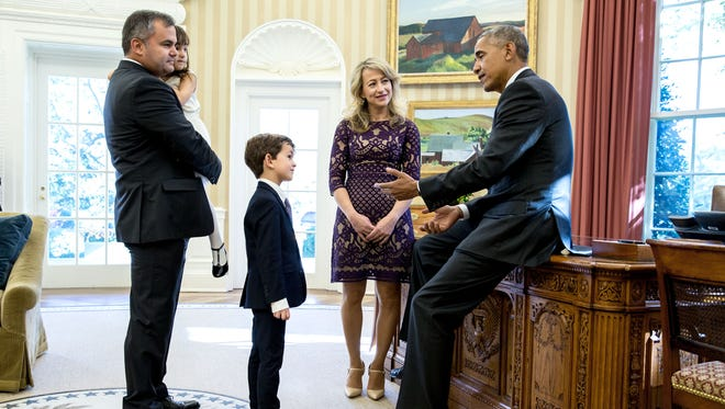 President Barack Obama meets with Alex Myteberi, 6-year-old letter writer from Edgemont, New York (asking if the young Syrian refugee Omran Daqneesh could live with his family), his mother, Valbona Myteberi, father, Elton Myteberi, and sister, Catherine Myteberi, during an Oval Office visit, Nov. 10, 2016. The president mentioned Alex's letter in a September 2016 speech at the United Nations.