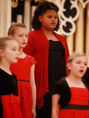 Eight-year-old Christiana Evans rehearses with fellow girls in the Virginia Girlchoir in before their inaugural performance on Saturday at Tinkling Spring Presbyterian Church.