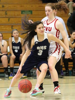 Burlington's Hien Thach drives around CVU's Sadie Otley during the Redhawks' 43-27 semifinal win Tuesday.