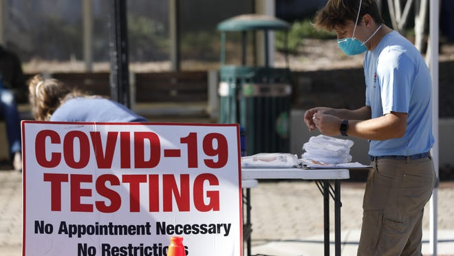 Athens-Clarke County Health Department staff set up for COVID-19 testing at its Downtown Health Fair on Wednesday next to City Hall. The fair offered free COVID-19 and HIV tests, flu shots, Hepatitis A vaccines and masks from 11 a.m. to 4 p.m. Wednesday and Thursday.