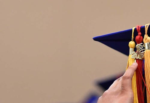 A TMCC Graduate marches in to the 2015 Commencement