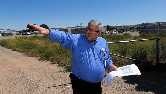 San Juan Regional Medical Center Vice President of Professional and Support Services Doug Frary points out the boundary of a proposed solar site in Farmington on Sept. 11. The project was rejected by the City Council on Tuesday.