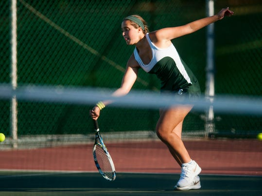 York Catholic's Sarah Koury reaches low to dig out a return against teammate Catherine Vizzard during the YAIAA class AA girls' tennis championship at South Western High School on Monday, Oct. 6, 2014. The all-Irish final ensured York Catholic seedings for district play. ( Jeff Lautenberger -- For GameTimePA.com)