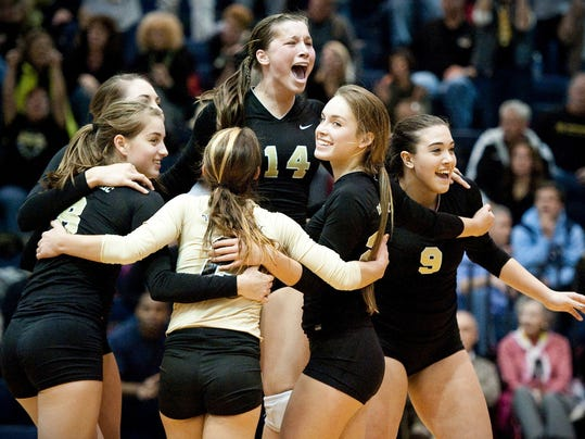 Madelynn Comly (14) celebrates with teammates after beating Berks Catholic to win the District 3 Class AA volleyball title Saturday night. (For the Daily Record/Sunday News --Jeff Lautenberger)
