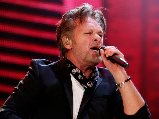 John Mellencamp performs during the Farm Aid 2012 concert at Hersheypark Stadium in Hershey, Pa., on Sept. 22, 2012.