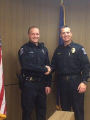 Public Safety Officer Donald LaPorte poses for a photo with Public Safety Director Frank Demers.