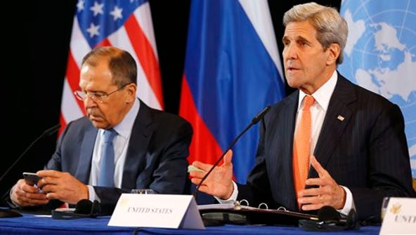 U.S. Secretary of State John Kerry, right, and Russian