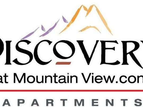 The logo for the Discovery at Mountain View apartment