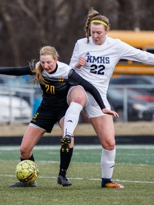 Kettle Moraine senior Tessa Lux (22) battles Germantown's Megan French during the game at Kettle Moraine on Thursday, March 29, 2018.
