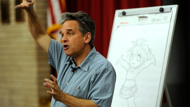 Author Mark Crilley talks about drawing characters for comic books during his presentation at Lib-Con on Friday, May 5, 2017, at the Abilene Public Library main branch. Lib-Con continues Saturday at the main branch. Highlights include Cosplay Chess at 9:30, Nerdy Speed Dating at 11, LARPing with Skywatch at 2 and a Cosplay Contest at 3 (registration from noon to 2:30). Vendors will be open from 9 to 3, food trucks from 11 to 2, and free comic books available while they last.