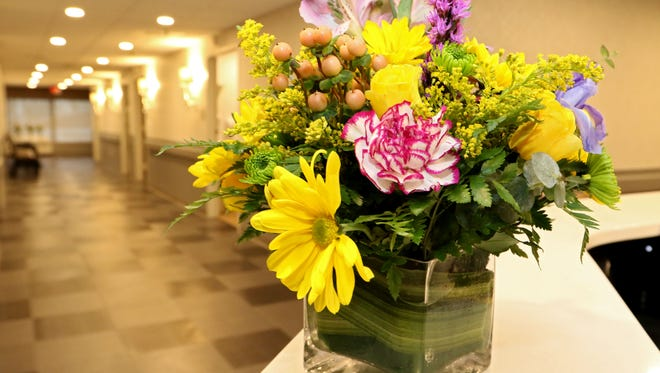 Flowers decorate the hallway inside the Runnells Center for Rehabilitation and Health Care.