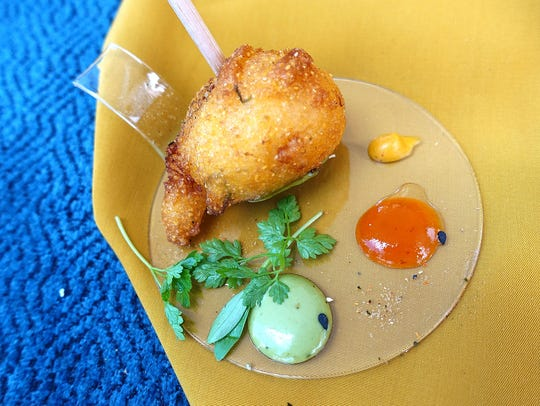 Takoyaki hush puppy with tomato Sriracha jam from The