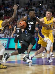 IMG Academy's Emmitt Williams drives to the basket in the semifinals of the 44th Annual Culligan City of Palms Classic at Suncoast Credit Union Arena in south Fort Myers.