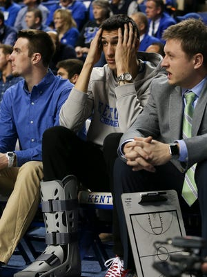 Injured UK player Derek Willis, #35, could only watch as his team played Alabama at Rupp Arena.