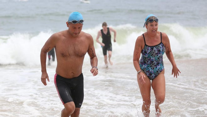Swimmers emerge from the ocean during a previous Ocean Games.