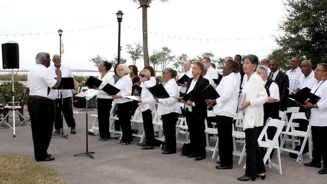 The choir sings during the fifth biennial Gospel & Gumbo fundraiser. The event benefits St. Joseph Medical Clinic.