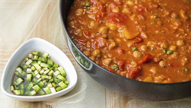Jamie Oliver's Super-Comforting Gumbo incorporates celery, onion, garlic, plum tomatoes, chickpeas and green peas along with red wine.